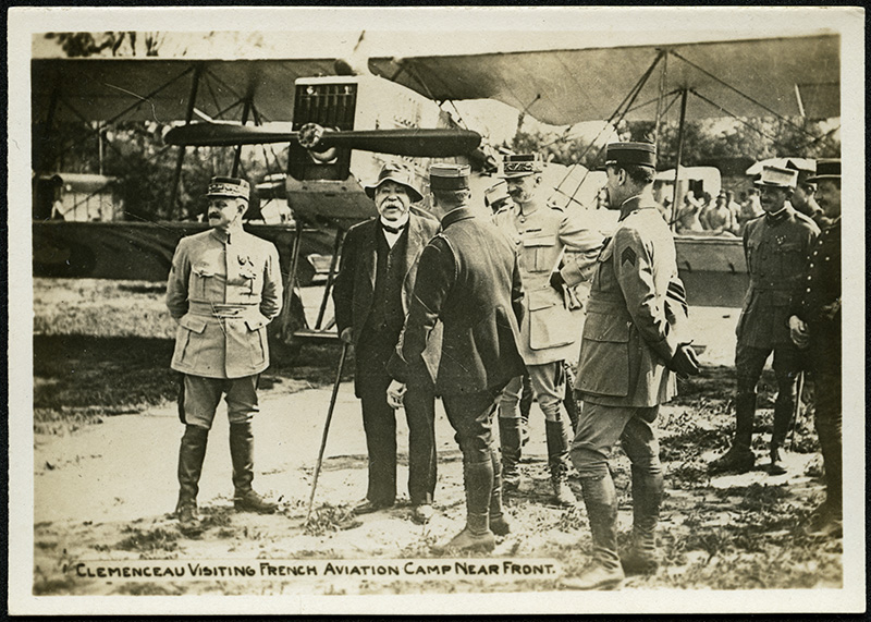 Clemenceau visiting French aviation camp near front.