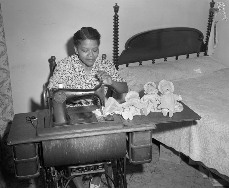 African American Woman Sewing